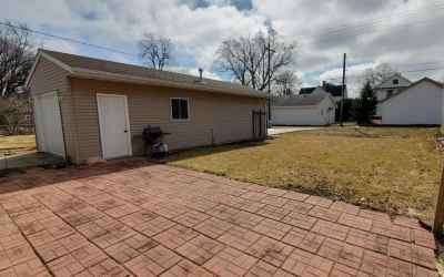 Detached garage with automatic doors on both ends
