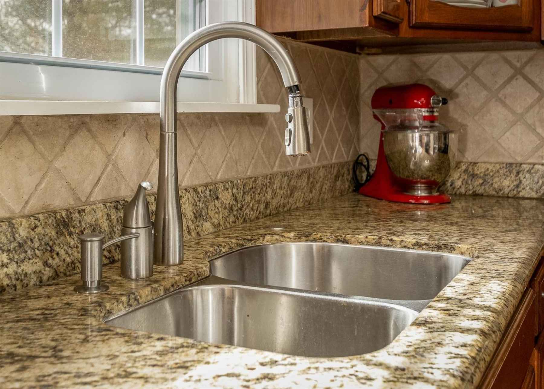 The backsplash just adds that special touch to this already gorgeous kitchen