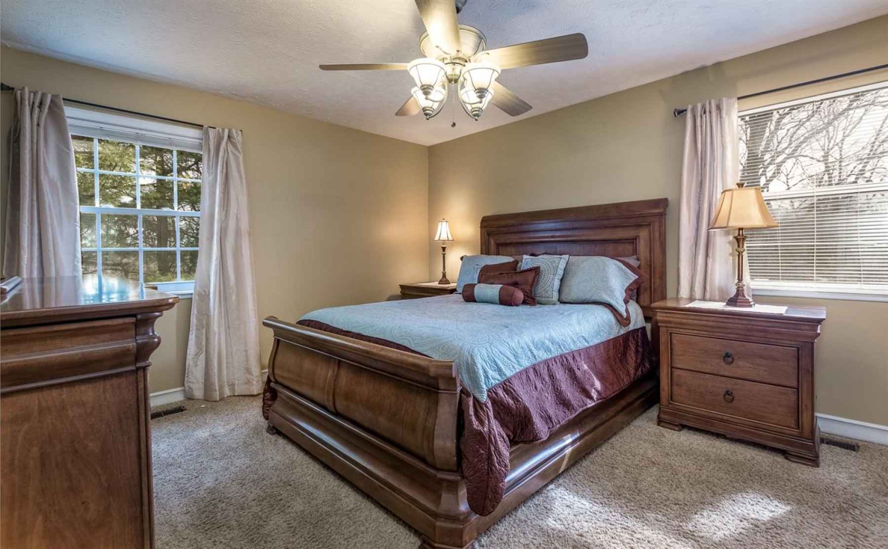 The master bedroom offers loads of natural sunlight