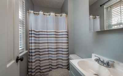 Master full bath has new updated tiled flooring and vanity