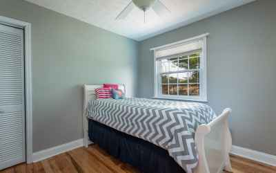 First of 2 guest rooms on main level.  Neutral paint, hardwood flooring and lots of natural light