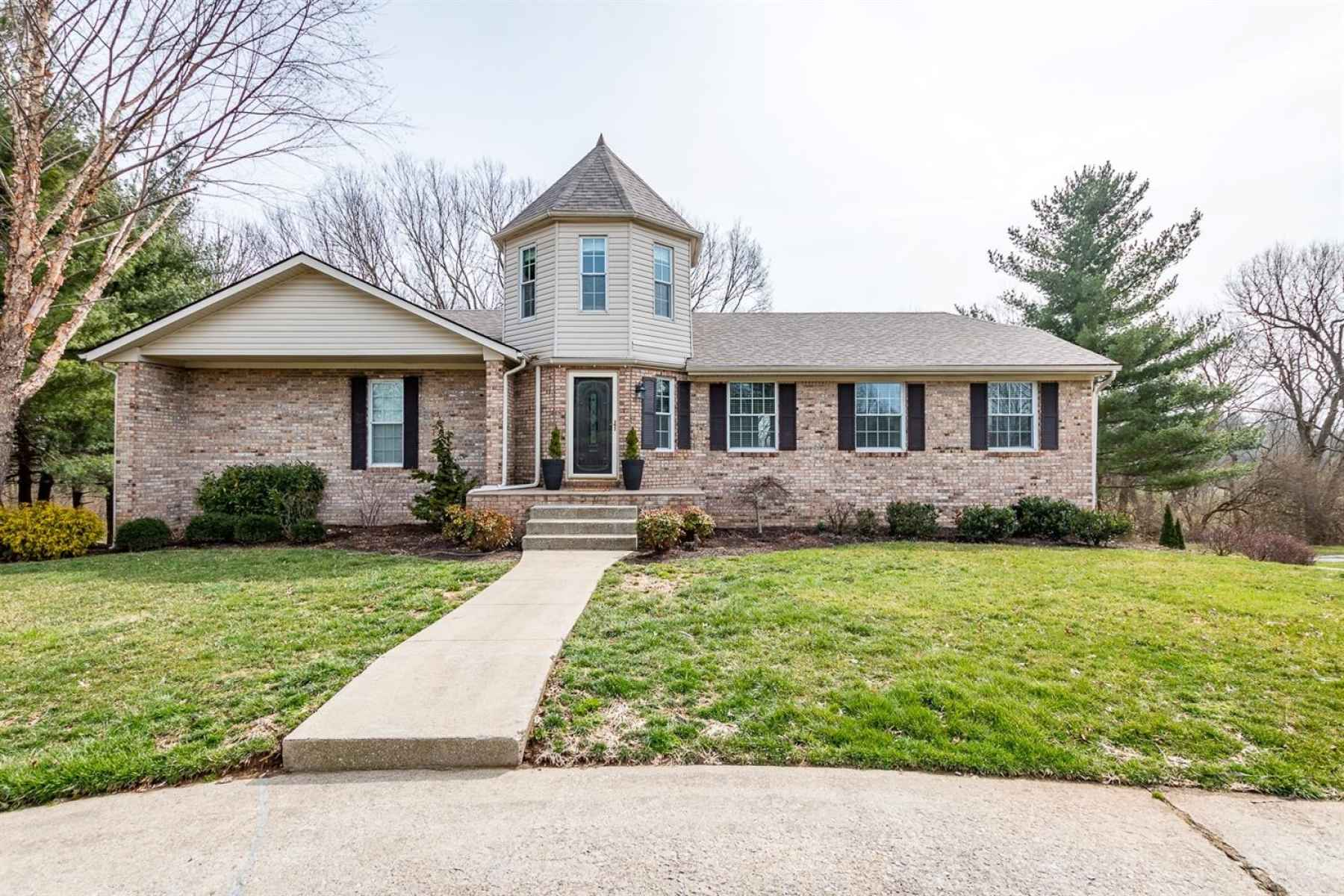 The home is situated on a lovely, wooded lot and has a circular driveway!