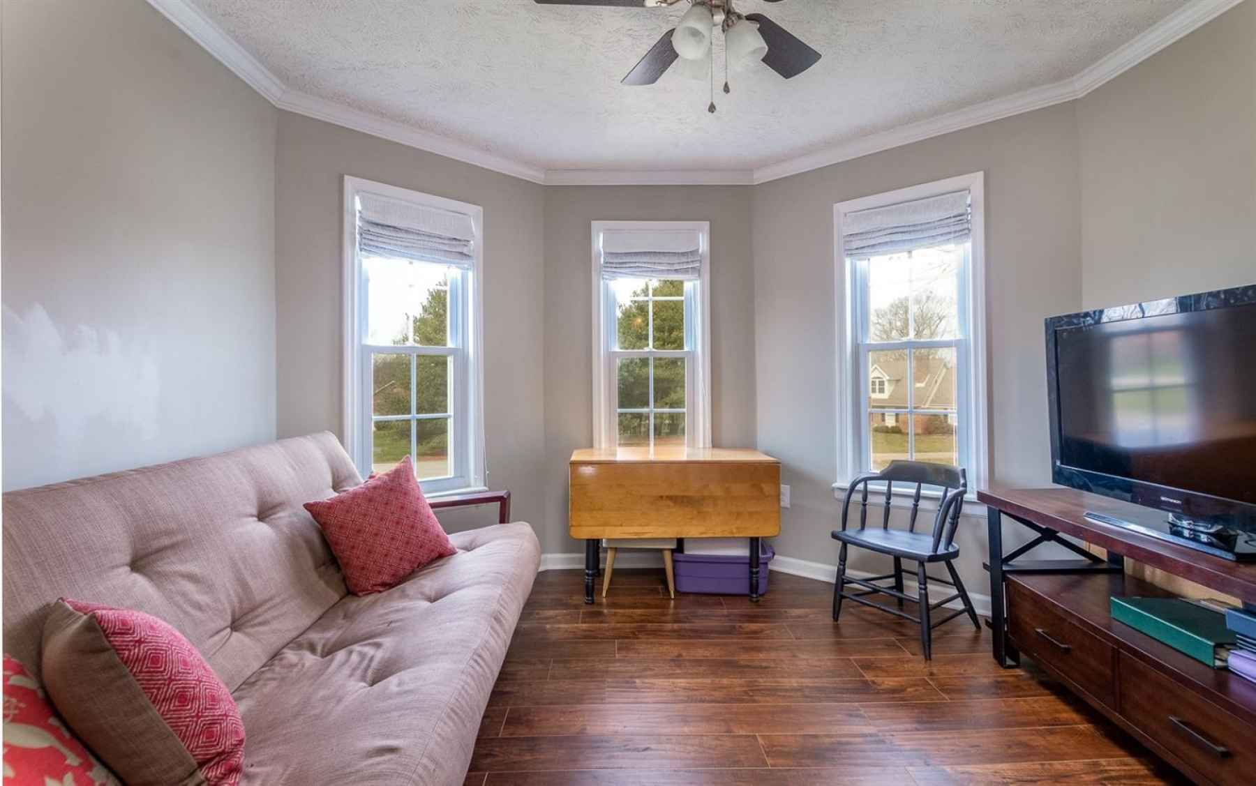 The bonus room on the second level is ideal for a second family room, play room or craft room!