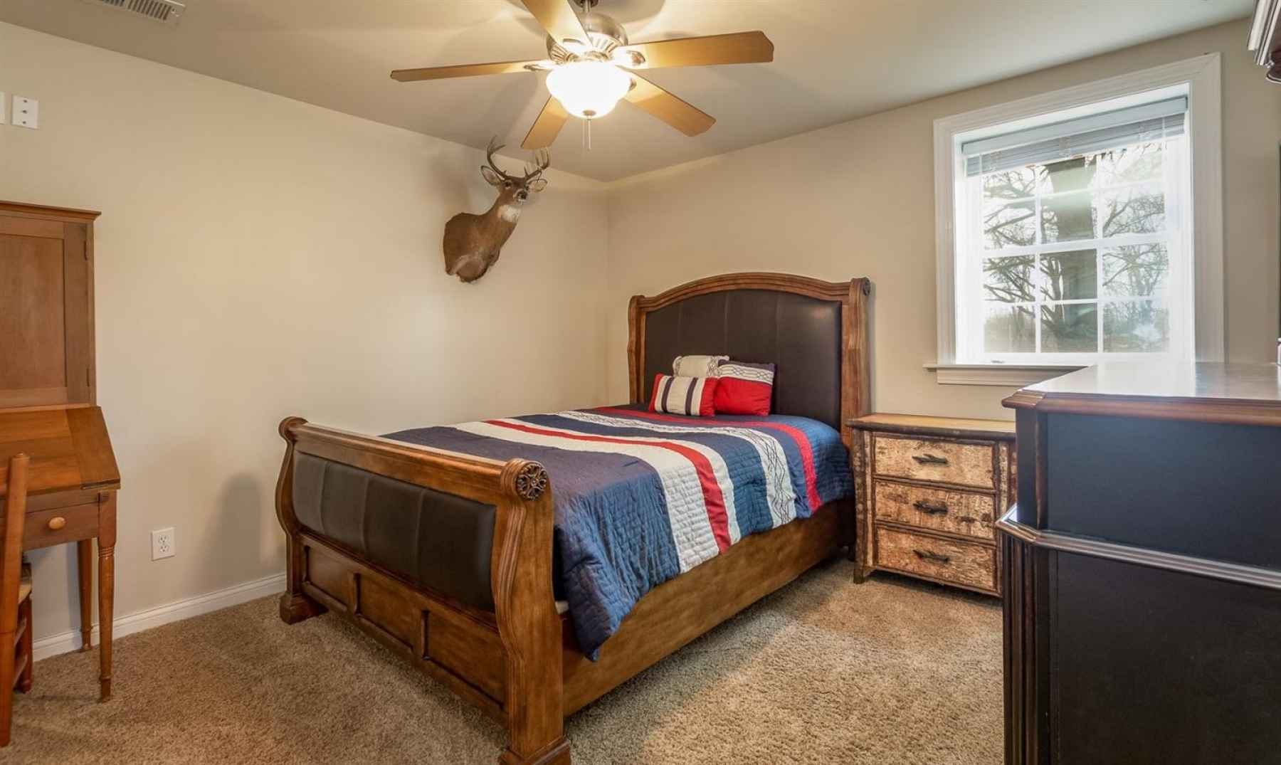 4th guest bedroom is located in the basement area.  Has ample closet space and a nicely sized window