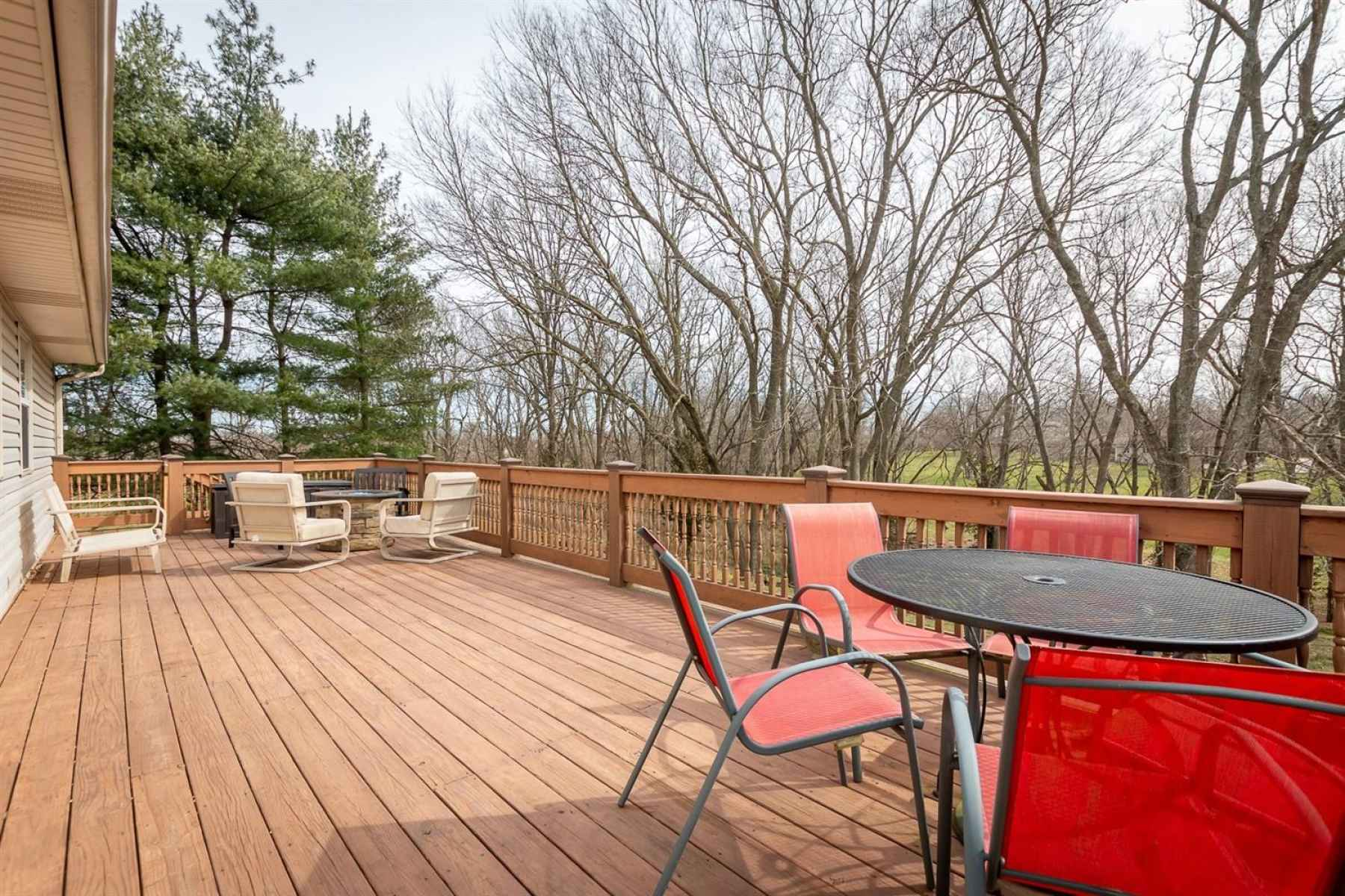 This large deck is just perfect for the upcoming spring days and nights!  And with all the trees on the lot, you almost feel like you're in a tree house!