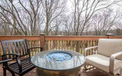 Enjoy outdoor times on this huge deck overlooking the wooded lot