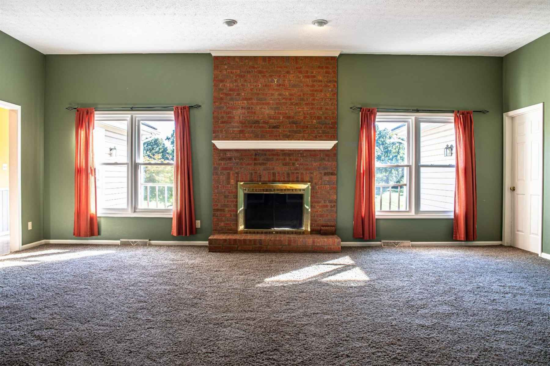 Natural Light & Fireplace Accent This Room