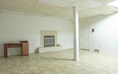 This Basement Is Huge And Has A Fireplace