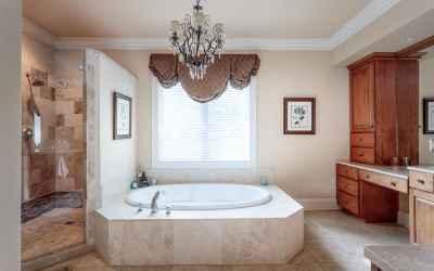 Master Bath with large custom tiled shower and large soaking tub.