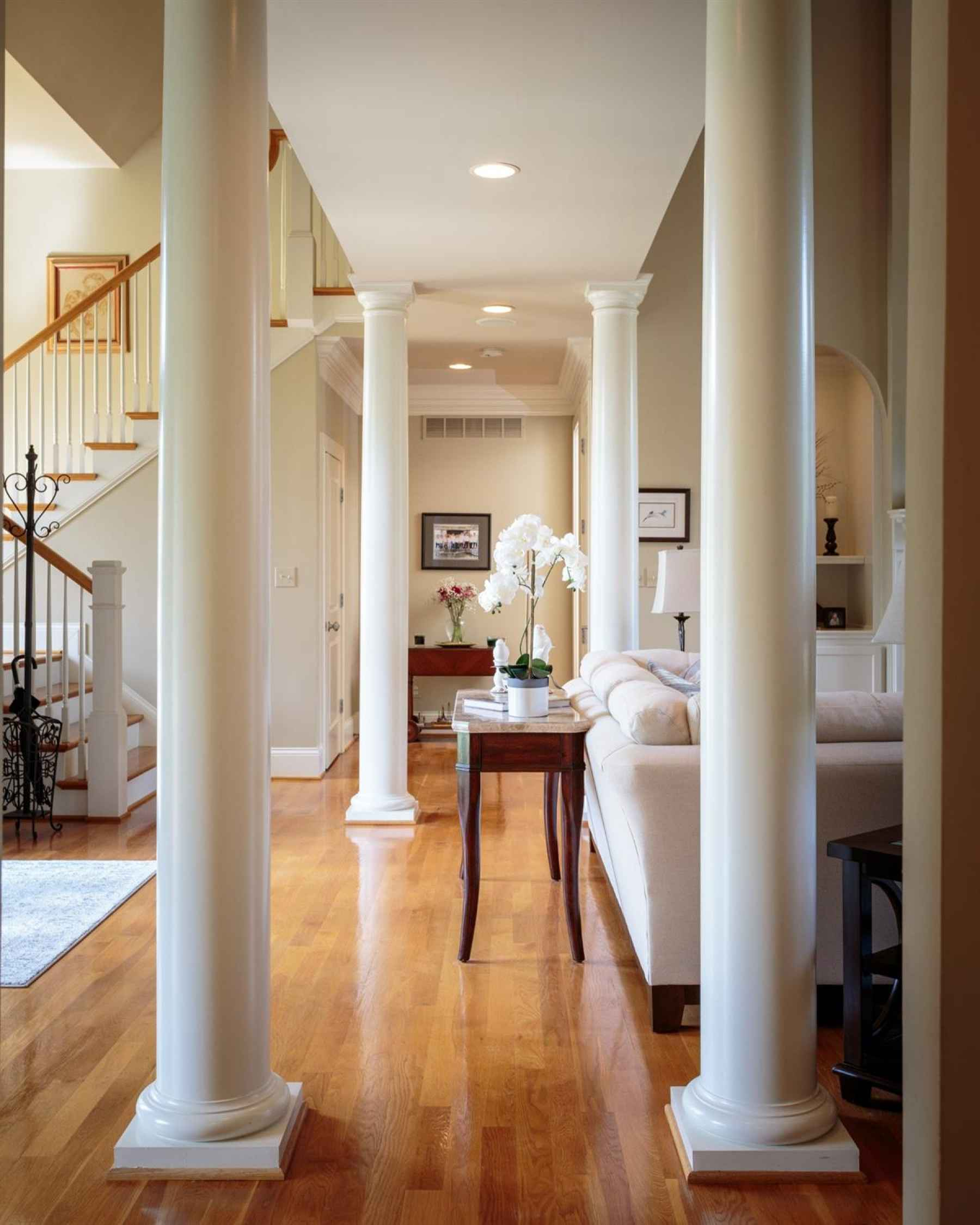 Foyer opens to the 2 Story Living Room. Master Suite is at the end of the hall to the right.