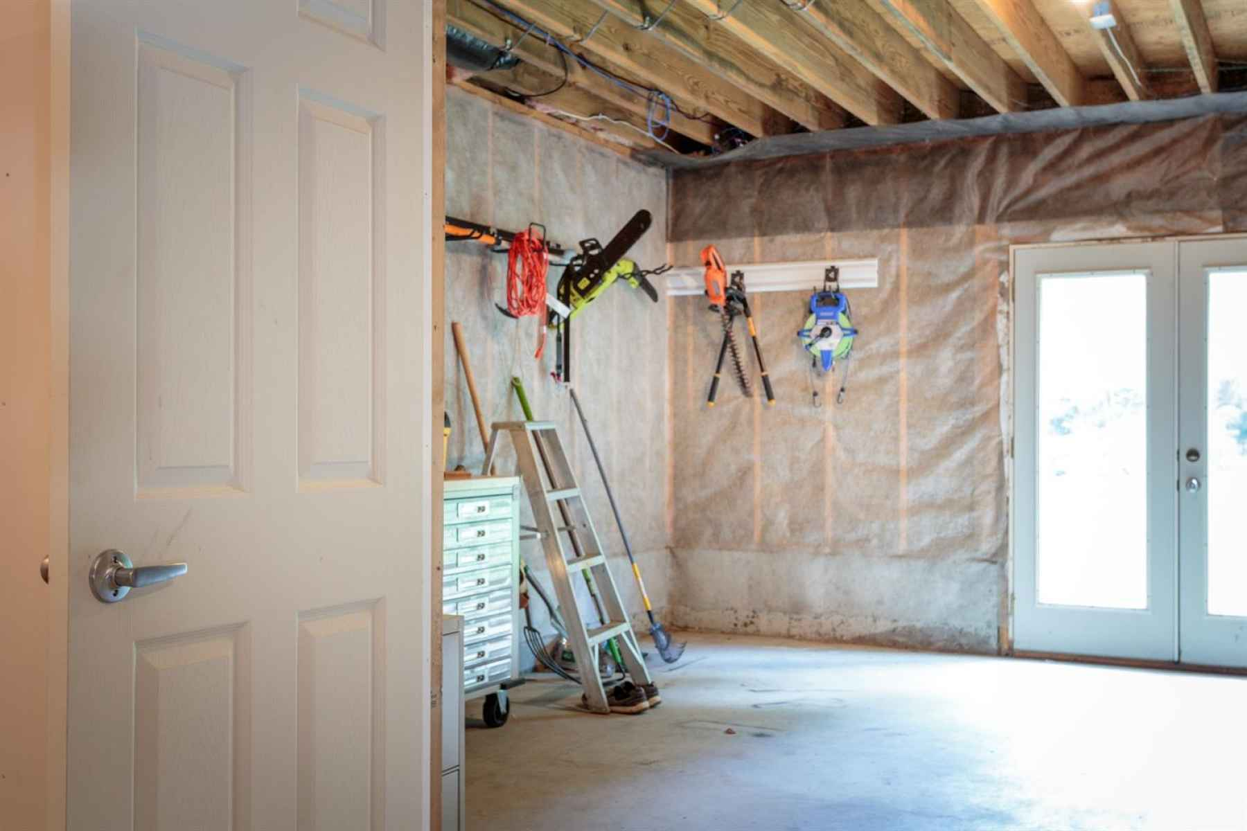 Walkout basement offers additional space to store lawn equipment and tools.