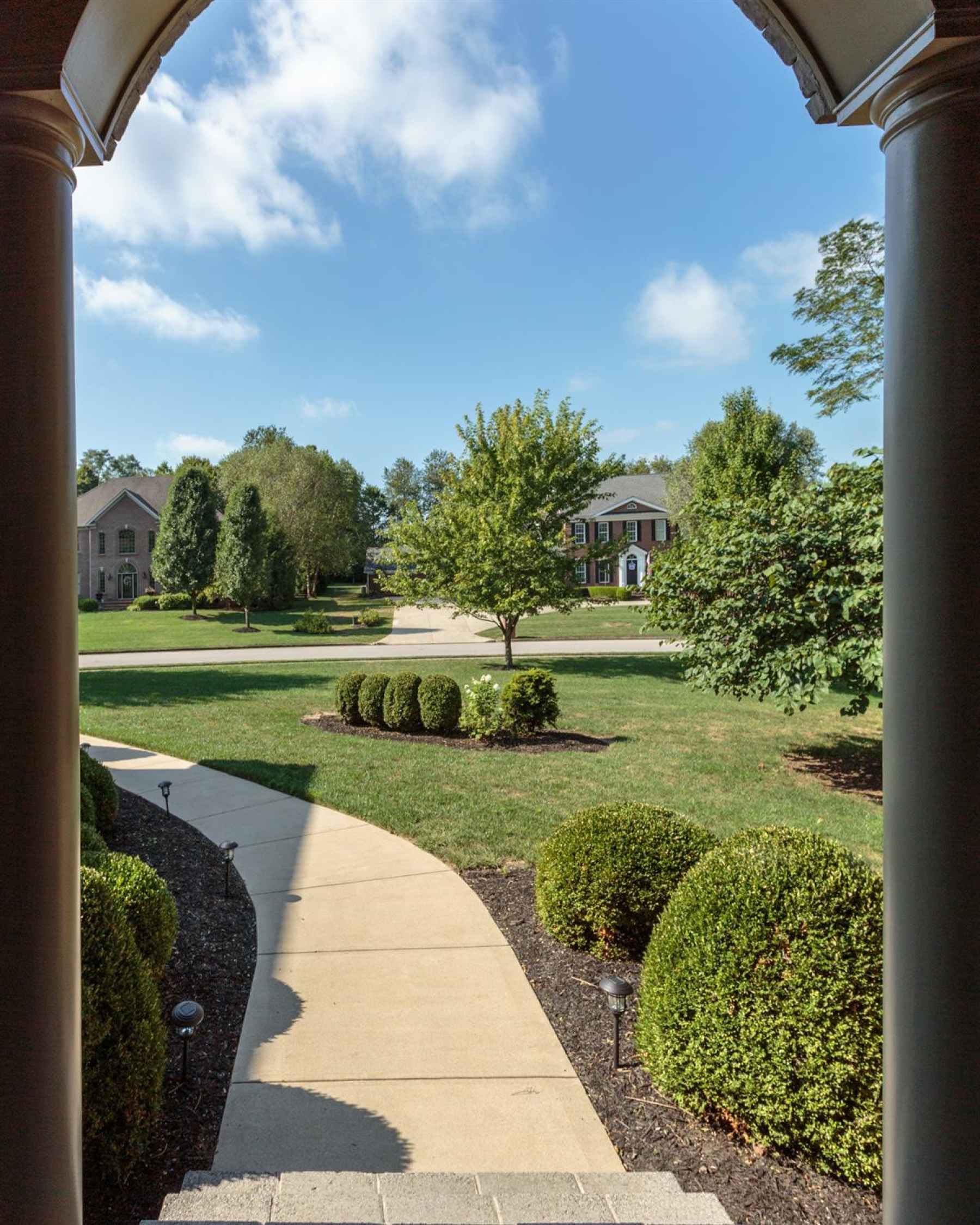 View from the front porch of the surrounding upscale homes in the neighborhood.