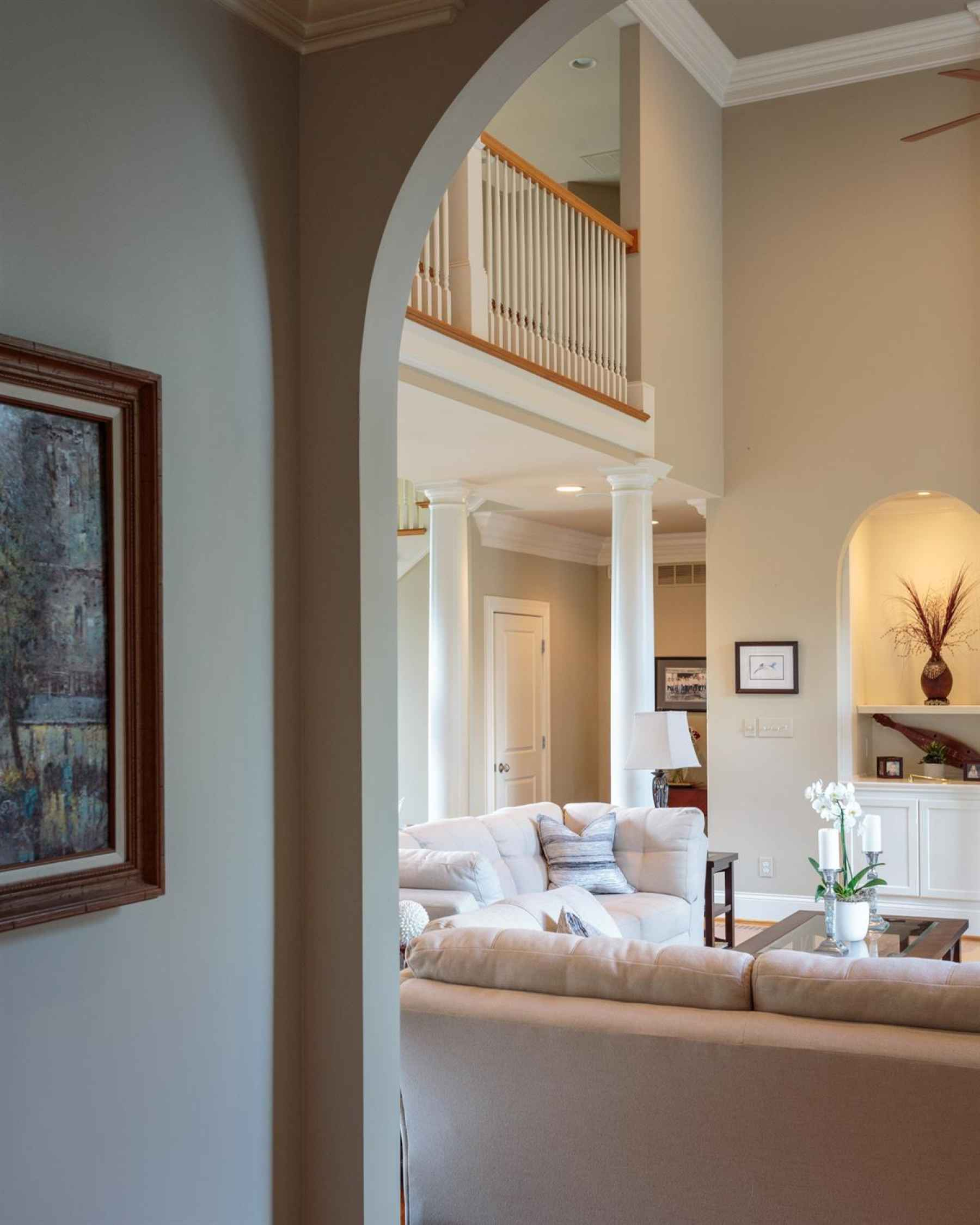 Arched doorways leading from Living Room to the Kitchen, Family Room and Breakfast Area of the home.