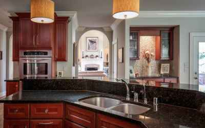 Kitchen with granite, double oven, separate bar and exterior door accessing the outside deck area.