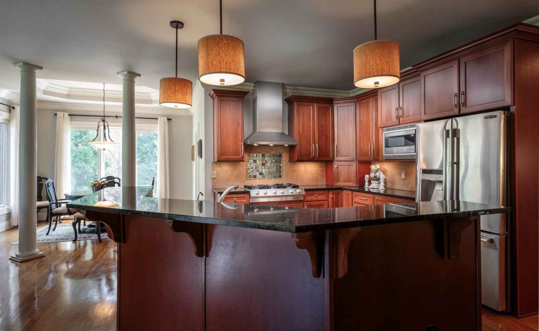 The Kitchen opens to the family room and breakfast area.