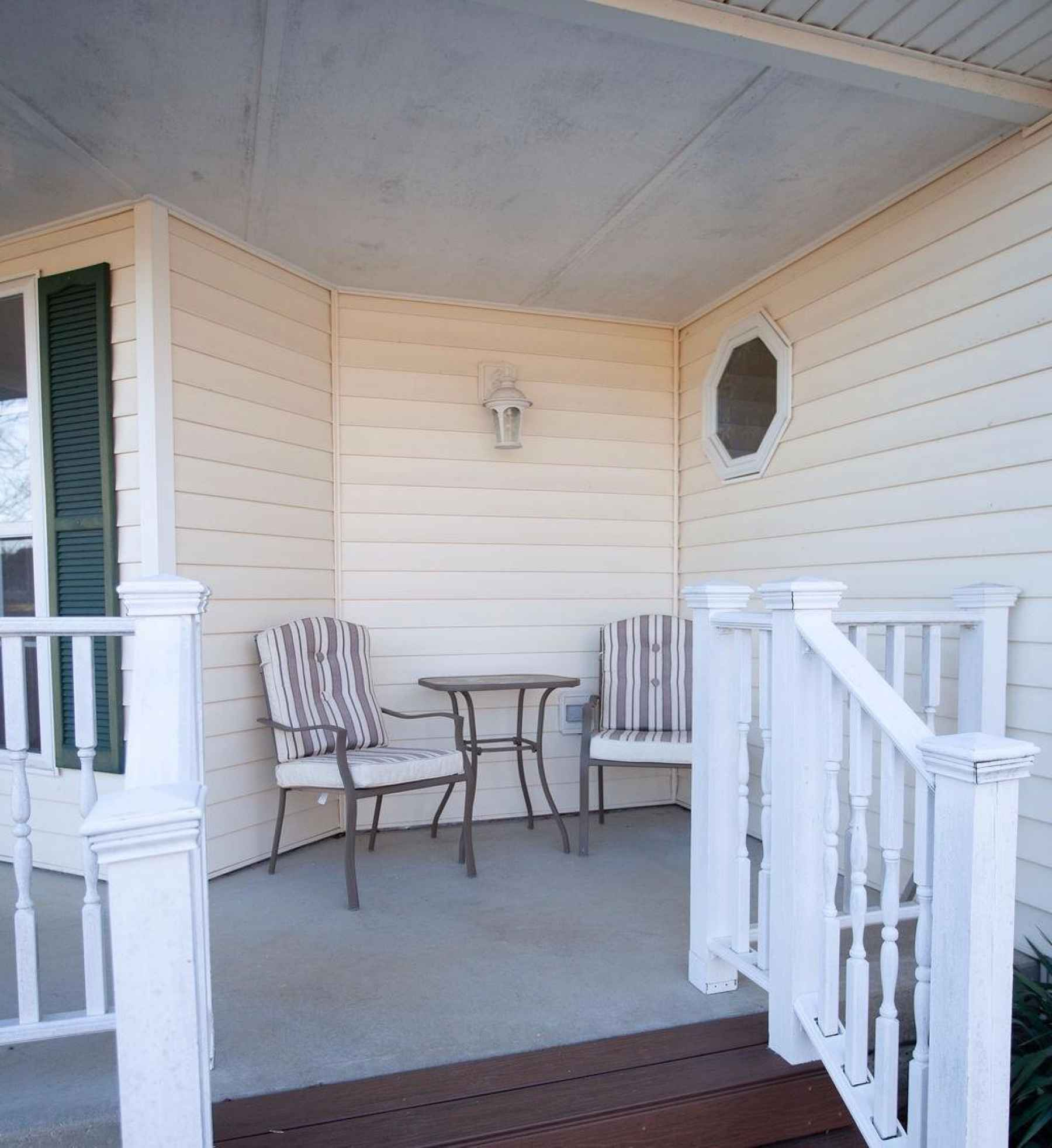 Come, sit and relax on your covered front porch and take in the beauty of the Fox Hollow neighborhood!