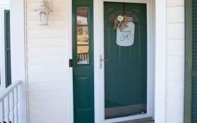 Welcome friends and family to your home through this beautiful entry way with a storm door.