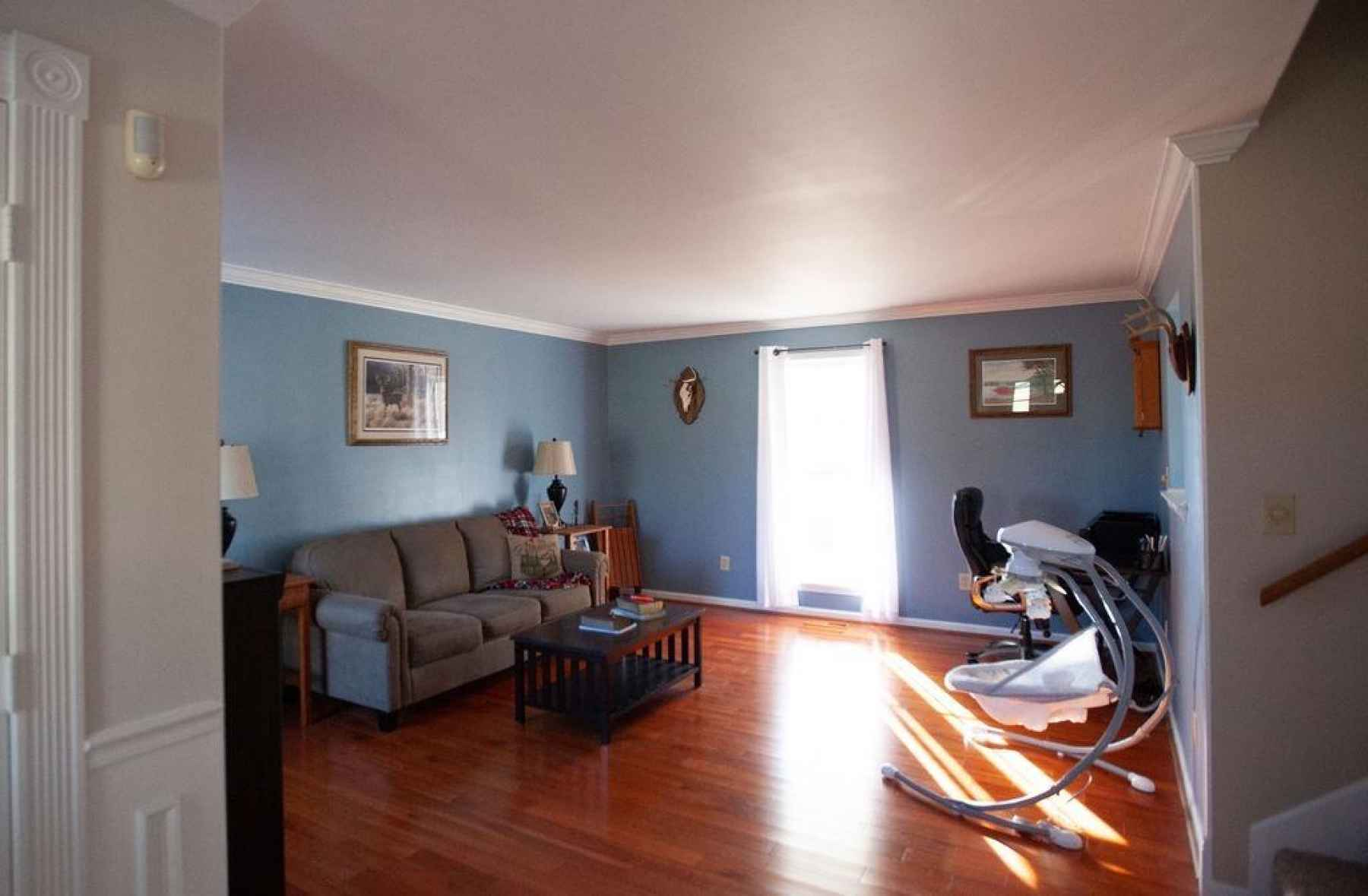 Spacious and beautiful Living Room! Notice the freshly painted walls and beautiful crown molding that helps create an inviting and comfortable setting!