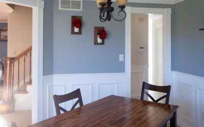 Turn right at the entry foyer and come into this charming formal dining room dressed with fresh paint, beautiful woodworking, and a stylish tray ceiling with a classy vintage light fixture!