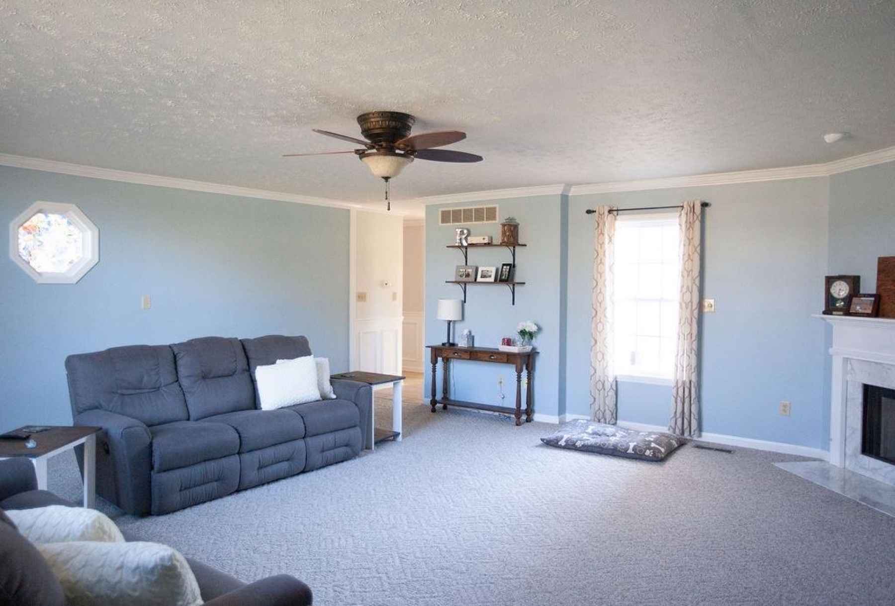 Off the hallway, you will make lots of memories in this super spacious den! You'll feel right at home with this beautiful berber carpet, tons of natural light and a gorgeous fireplace with gas logs.