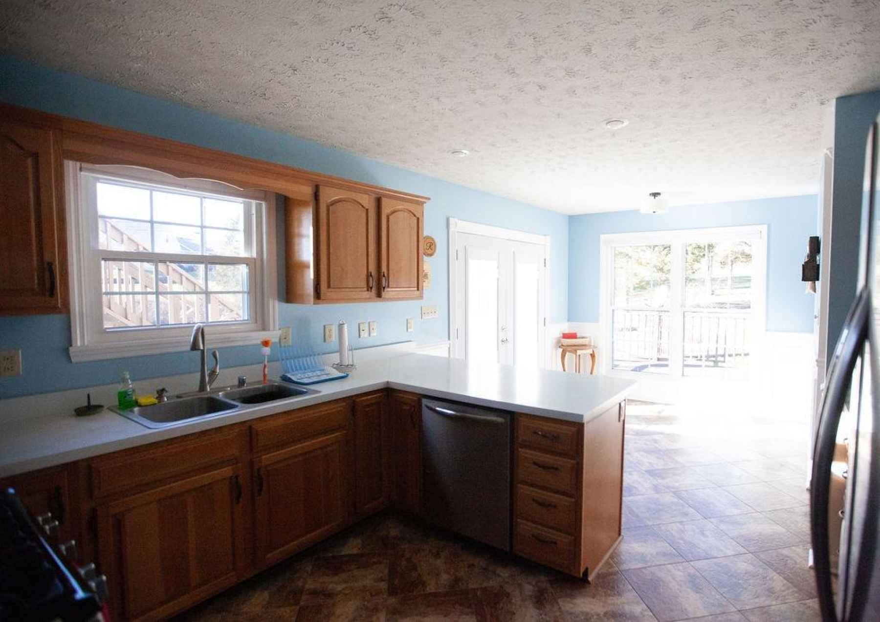 There's plenty of natural light in this spacious kitchen with new windows with lifetime warranties and a French door that leads out onto the rear deck. The stainless steel dishwasher was replaced in 2016.
