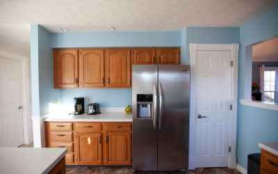 The stainless steel refrigerator stays with the home and was purchased in 2016.