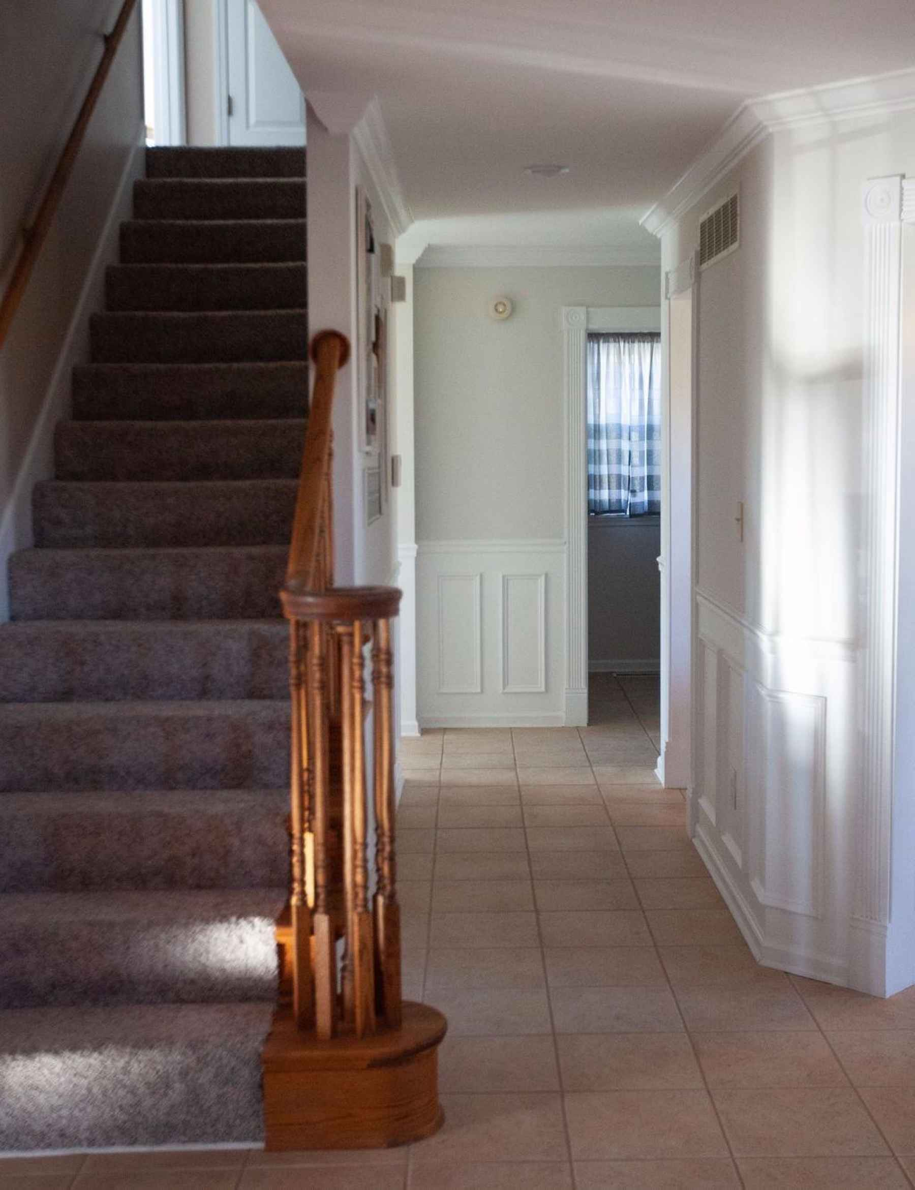 Beautifully carpeted stairs leading up to the 2nd floor master suite, 2 other bedrooms and 2 full baths.