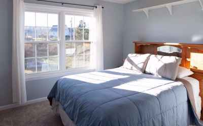 Upstairs bedroom with fresh paint, new carpet and a double window with a beautiful view!