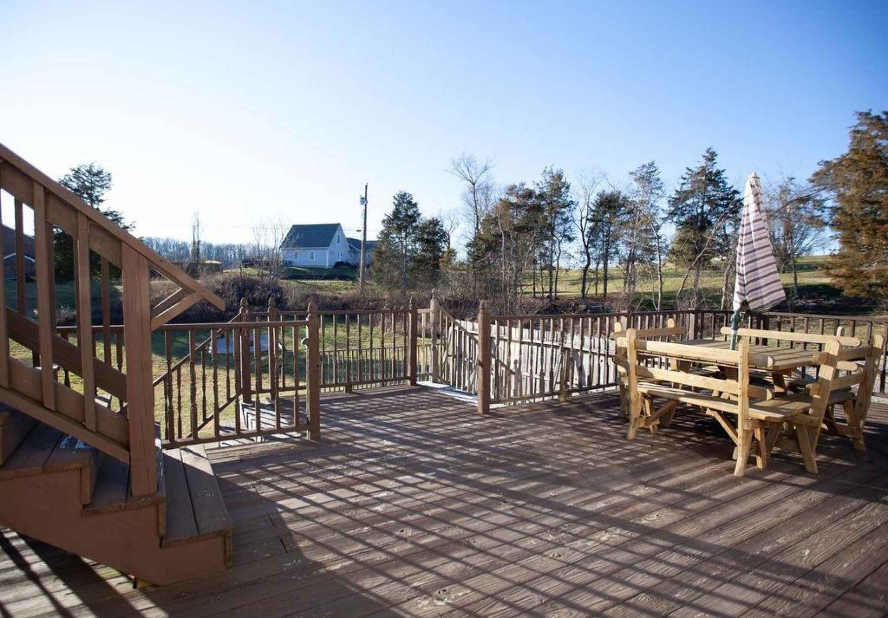 Enjoy the view on this large upper wooden deck with plenty of room for entertaining family and friends!