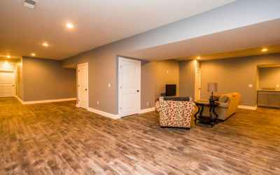 The basement features a kitchenette area with granite counters, full bath, a bedroom with a walk-in closet, a rec room, & a cool bonus room with built-in cubbies.