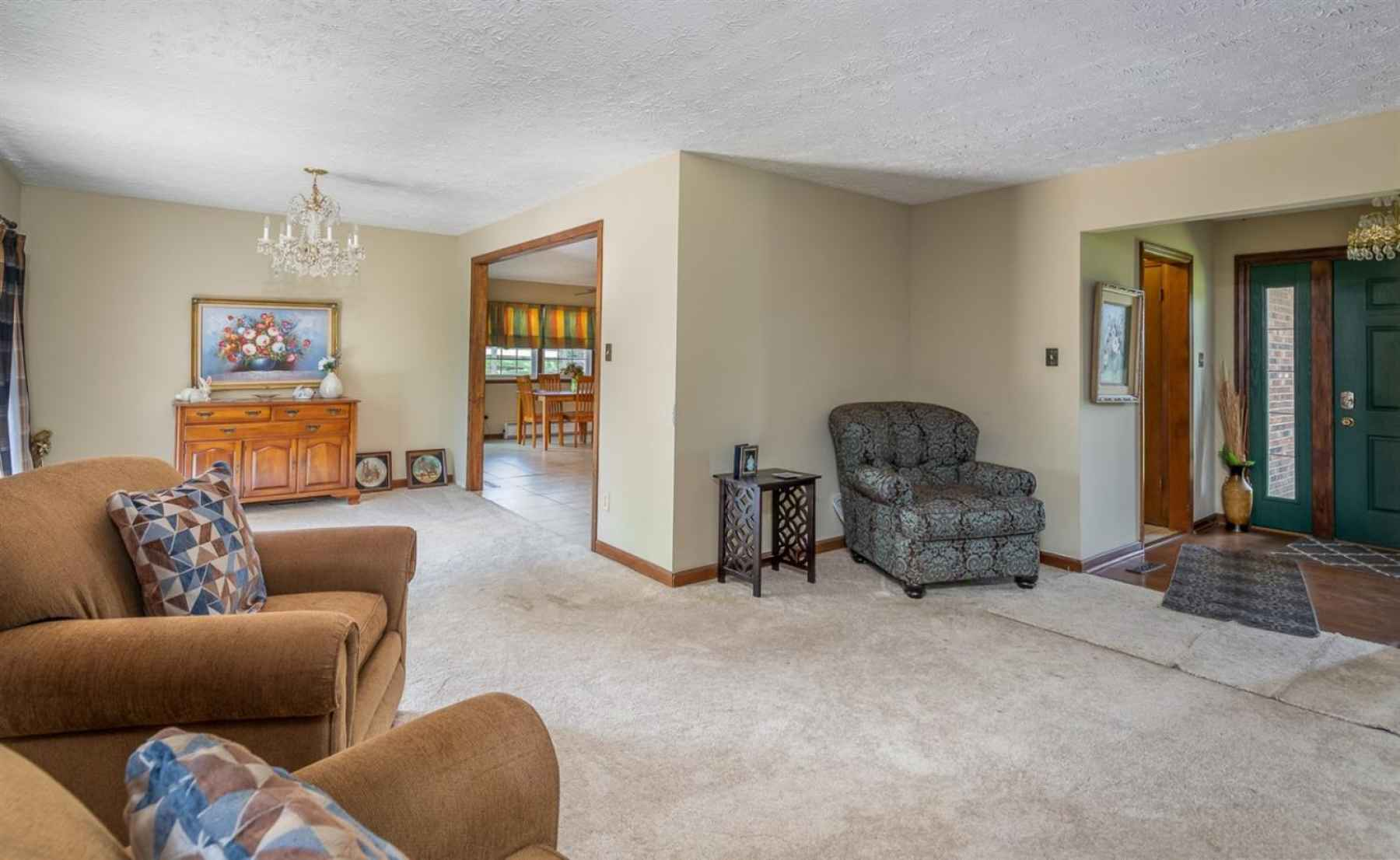 The first floor houses a large living room/dining room combo with wonderful, serene views of the land