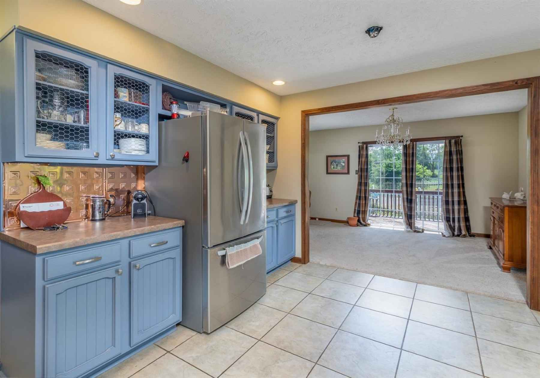 The kitchen opens up to the formal dining room/living room combo. The perfect place to sit back and enjoy those views!