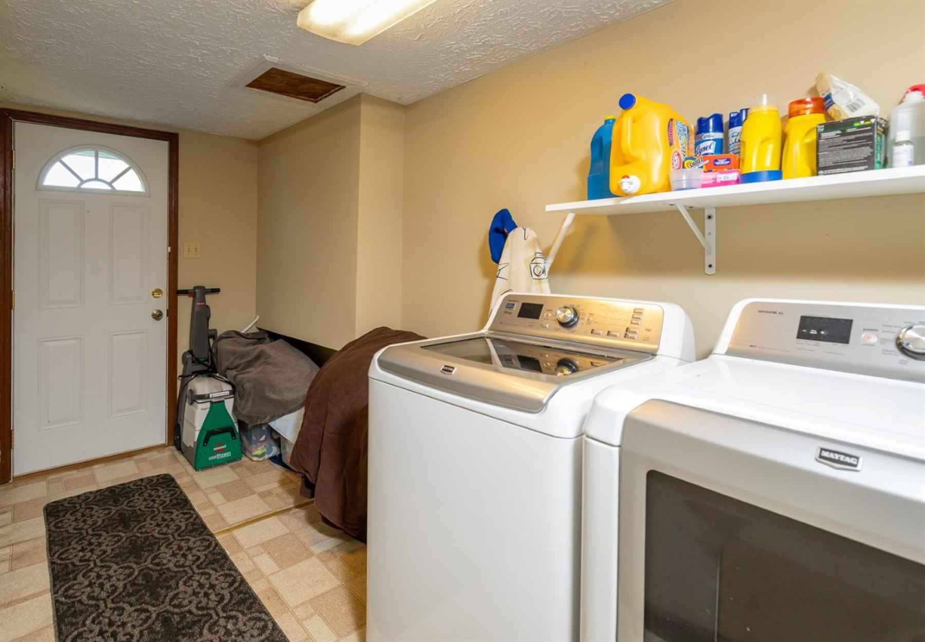 The laundry/mud room is located on the lower level