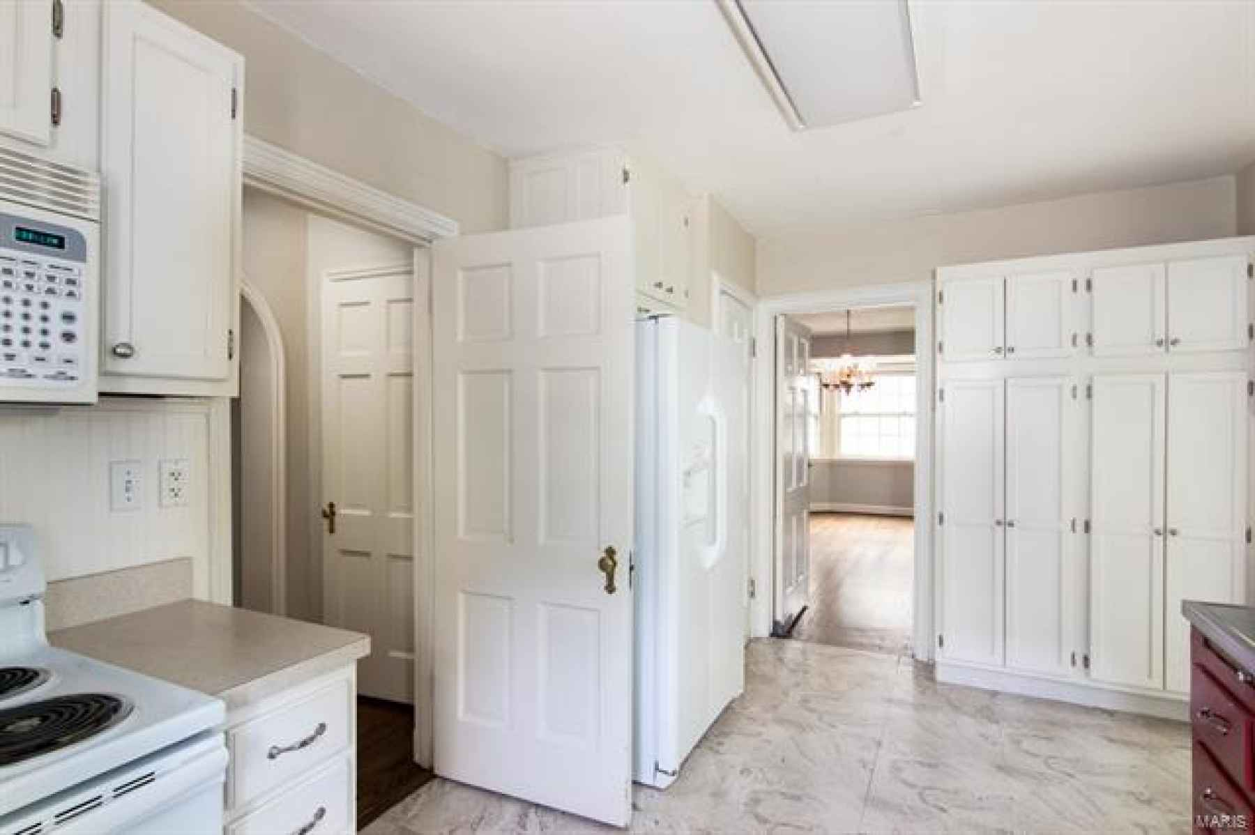 Plenty of Storage with a Pantry to the Right of the Refrigerator - OR, open wall and hallway closet to enlarge kitchen and open into the dining room.