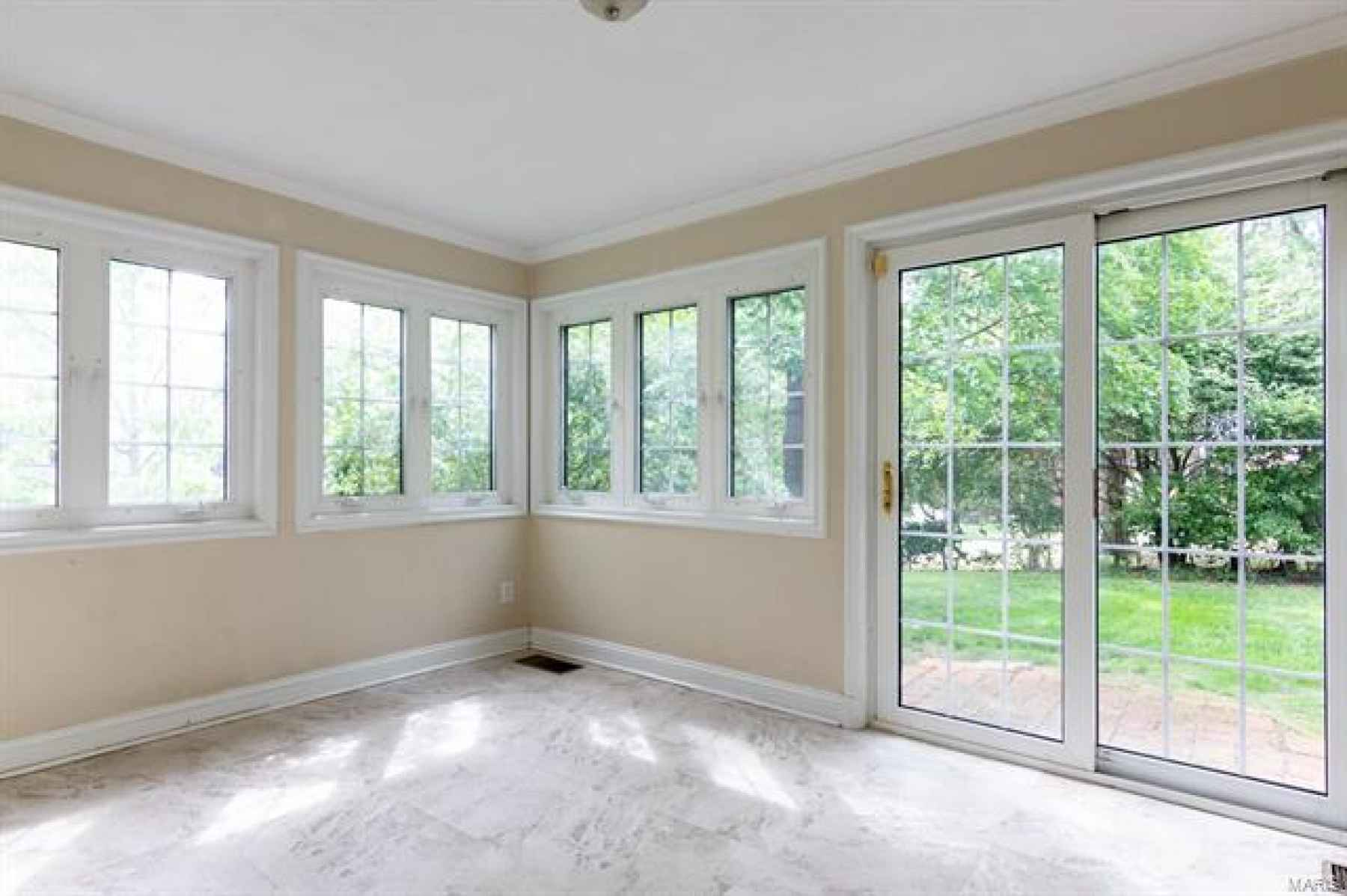 Breakfast Room off Kitchen Features Windows on Two Walls, Sliding Doors to the Backyard.