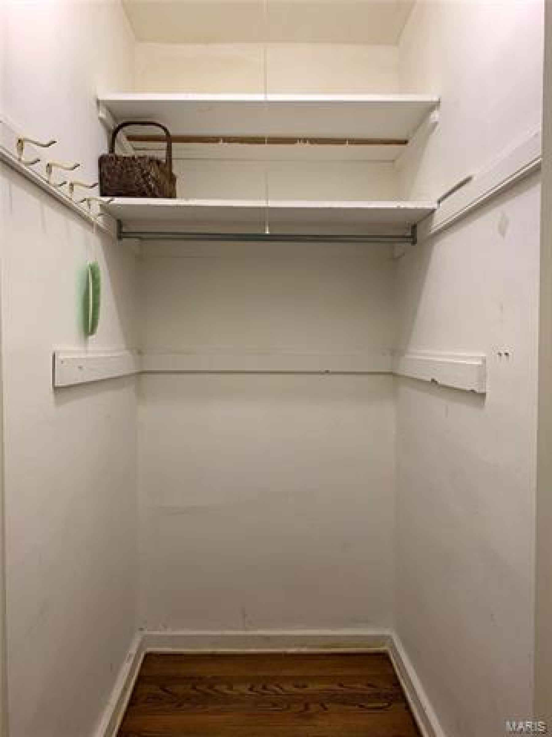 Walk-in Closet on Main Level - Located in Hallway - Would be excellent space to extend the kitchen and open into dining.