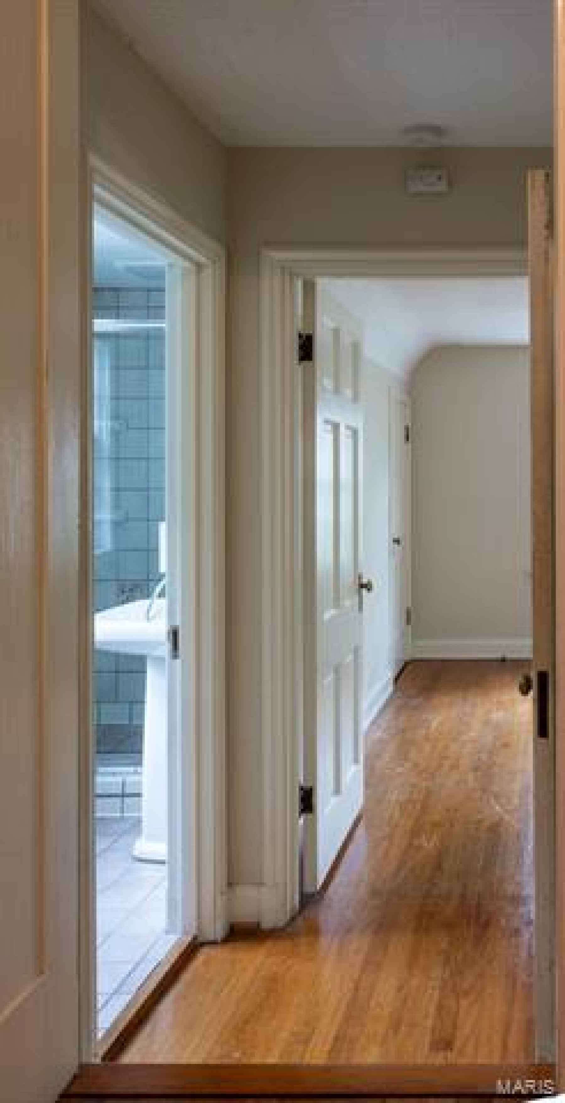 Upper Landing - Step Down to a Bedroom, Full Bath, and Cedar Lined Closet