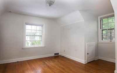 Bedroom with Dormer, Hardwood Floors, Adjacent to Bathroom and Walk-in Hall Closet