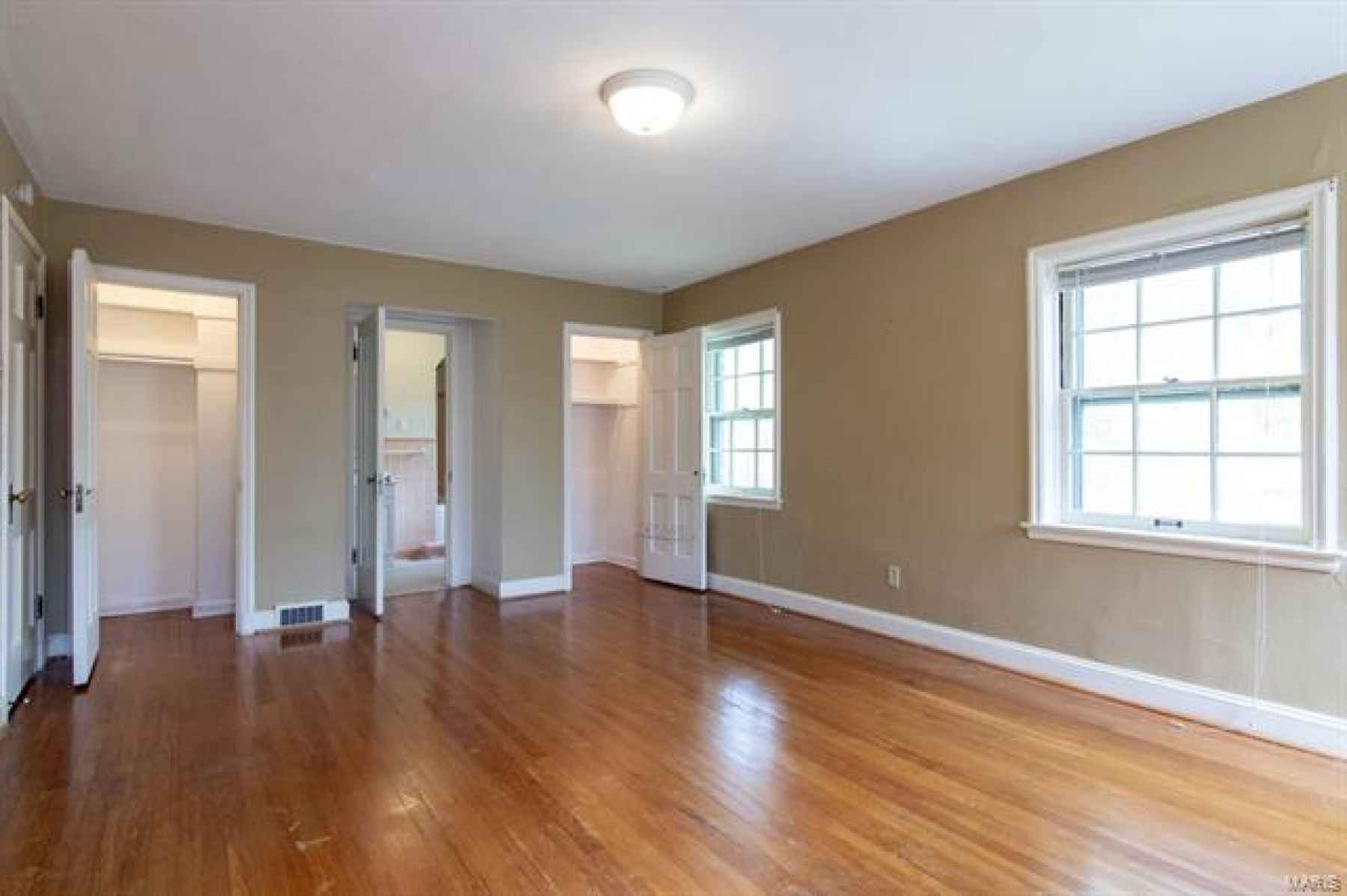 Bedroom Features 2 Closets, Access to Full Bath, Natural Light