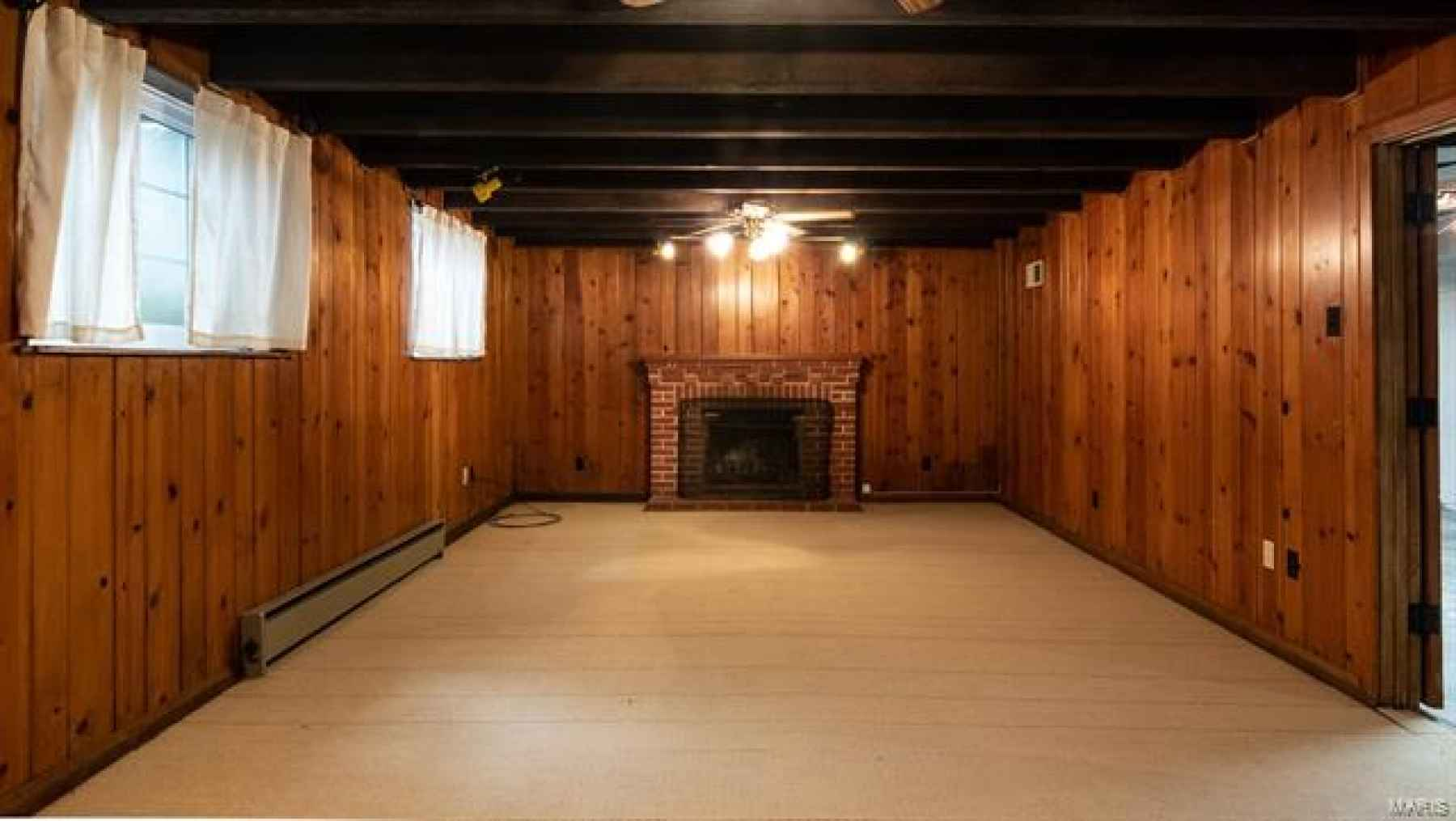 Lower Level Rec Room with Wood Burning Fireplace