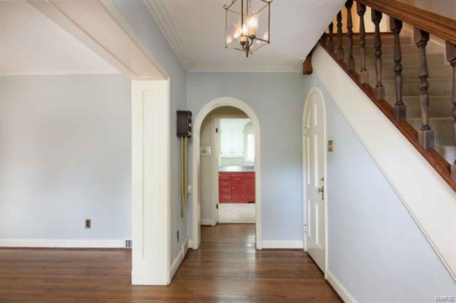 Entryway - Beautiful Hardwood Floors, Arched Doors, & Crown Molding