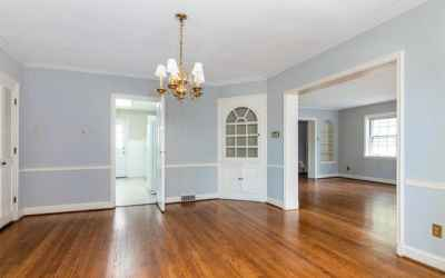 Lovely Built-in Cabinet, Crown Molding, Chair Rail and Natural Light