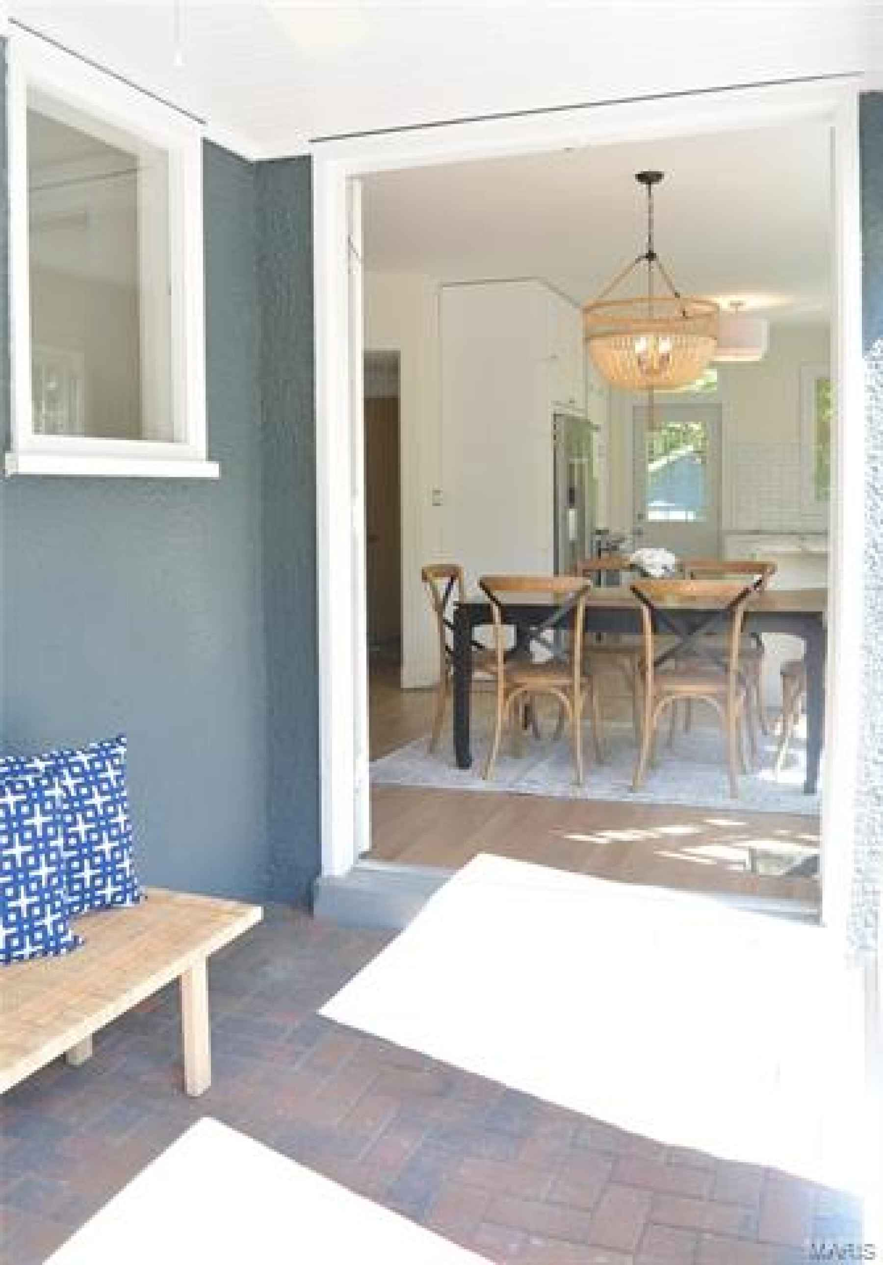 Front wrap around porch with French doors into dining room area.
