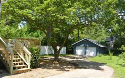 2 car detached garage with 2 new garage doors. All new painted and partial fenced yard.