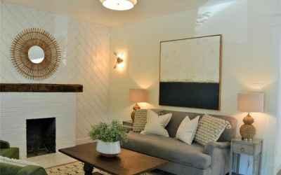 Living room with custom shiplap wall in the herringbone pattern.