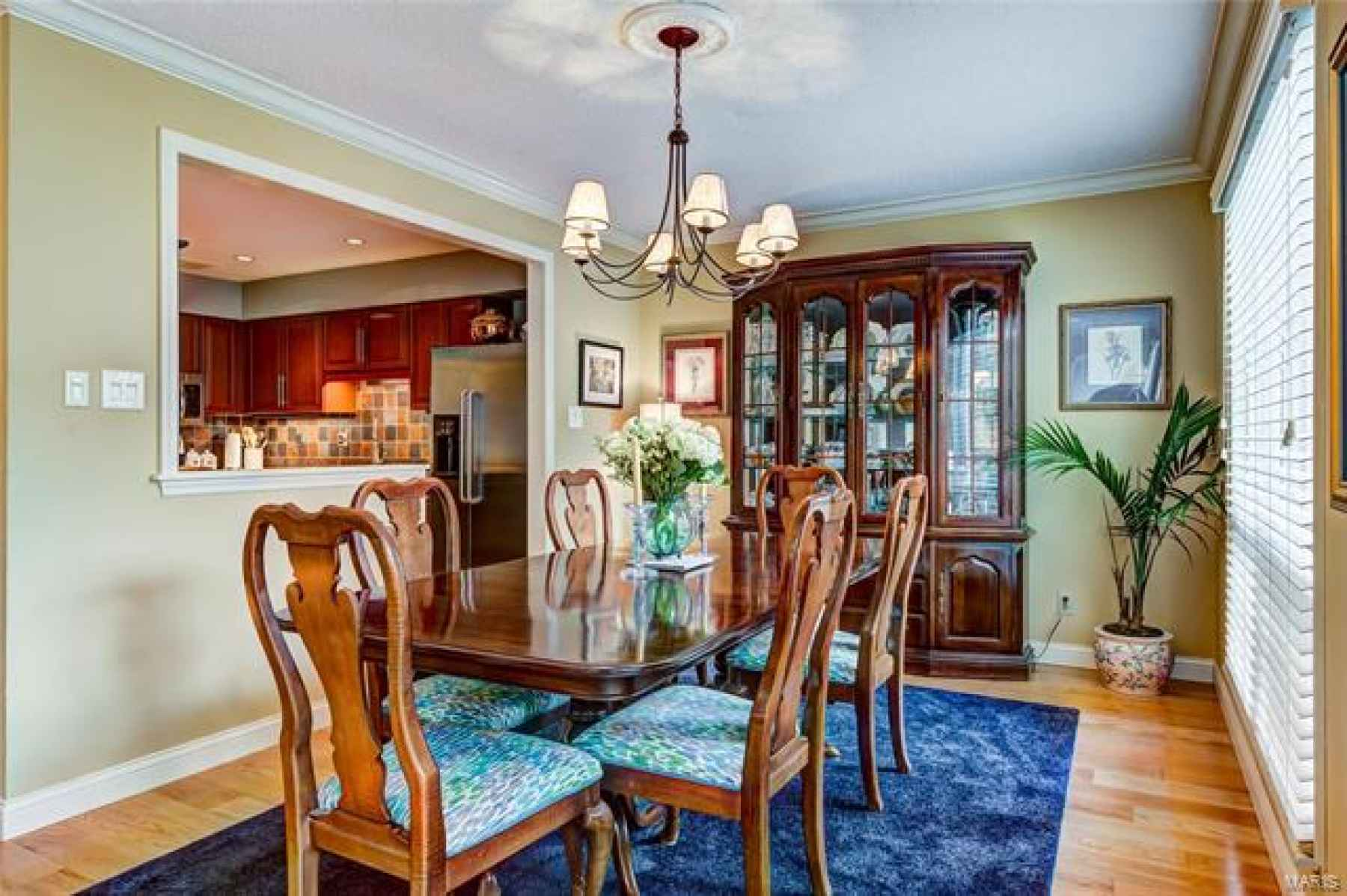 Current owner opened the wall between the dining room and kitchen creating the open space everyone desires