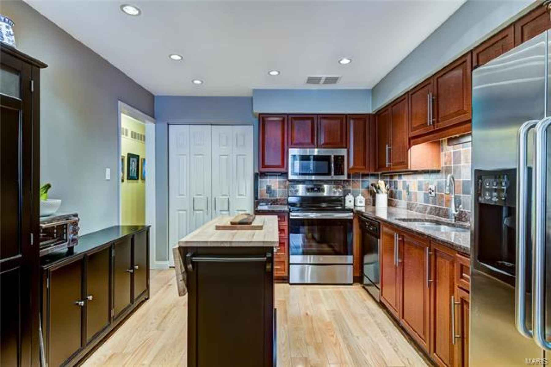 Stainless appliances (new range and microwave), wood flooring, granite creates the perfect kitchen space!