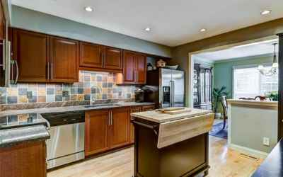 View of kitchen looking into dining room.  Look at the natural light that window provides