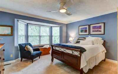 Spacious master bedroom with 9' bay window