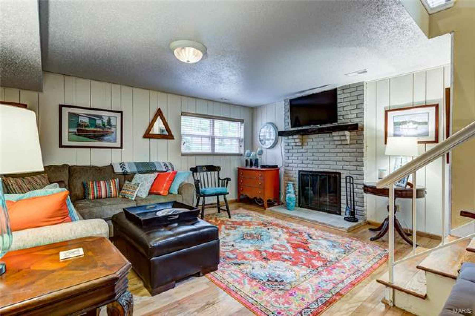 A few steps away is the incredible family room with fireplace!